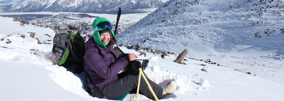 A researcher collects data on snowpack properties in Alaska.