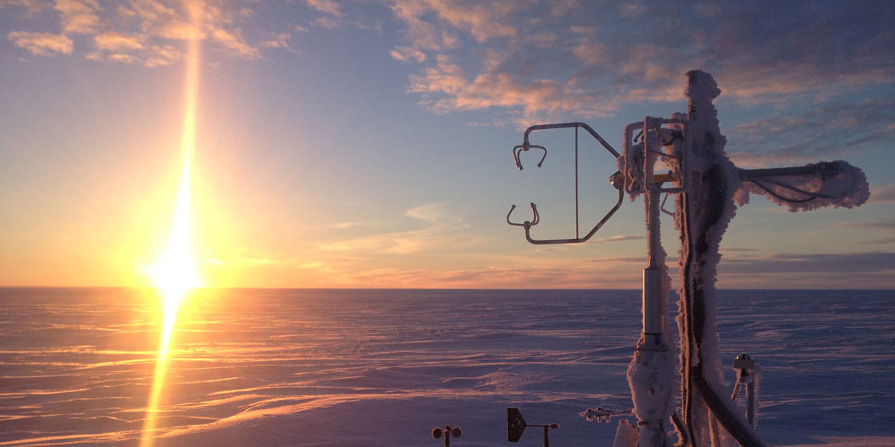 Frost clings to an eddy covariance tower in Barrow, Alaska. The sensors measure methane emissions year round and are equipped with deicers to prevent them from malfunctioning in the Arctic's frigid temperatures. The tower also measures other meteorological variables, including air temperature, humidity, soil temperature, and soil moisture. (Courtesy S. Losacco)